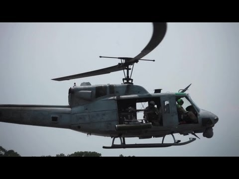 Marines from Marine Wing Support Squadron 271 refuel and rearm a pair of UH-1N Hueys Iroquois from Marine Light Attack Helicopter Squadron 467 at Marine Corps Auxiliary Landing Field Bogue,...