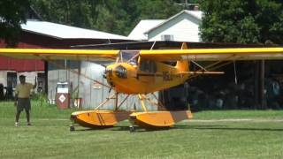 Angelica14709  American Legend  J-3 Float Plane Take off Grass