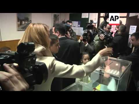 Serbian Progressive Party leader Vucic and Socialist Party leader Dacic voting