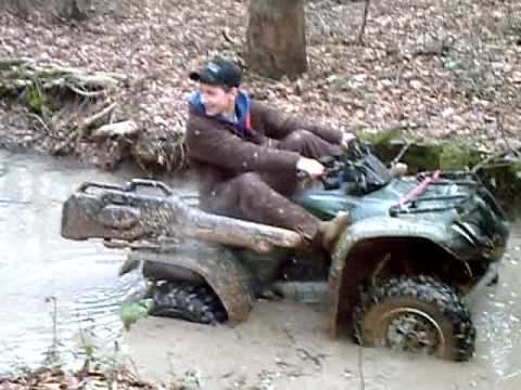 Getting the four wheeler stuck in 8 inchs of water!
