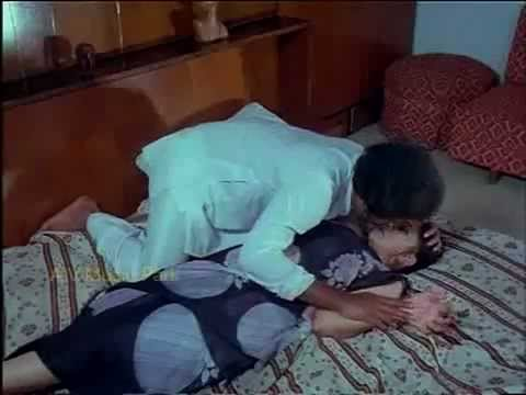 tamil old actress lakshmi hottest scene . she goes to bathtub and get current.there enters the hero to save her.she takes her to bed and scratches her legs a...
