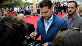 Henry Cavill & Guy Richie sign autographs as The Man From U.N.C.L.E Premiere Somerset House, London
