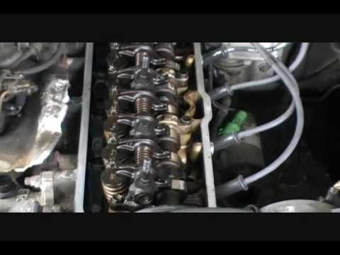 Adjust valve lash on pontiac engine