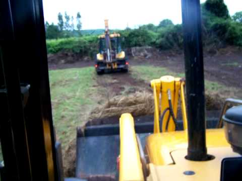 Two Fermec 860 diggers making silage part 2
