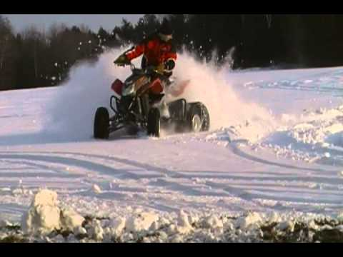 racing fourwheeler with snowmobile tracks