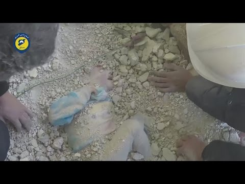 Young girl miraculously rescued alive from rubble in Syria