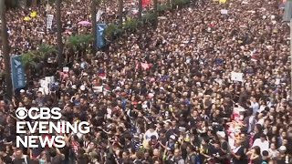 Hong Kong protesters flood the streets demanding city leader's resignation