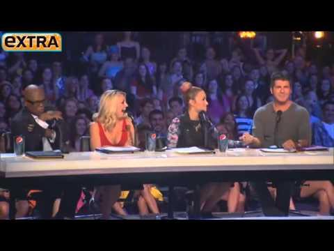 Demi Lovato cuspindo pastilhas de menta na mão de um jurado do The X Factor