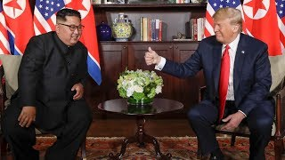 An historic handshake: Donald Trump and Kim Jong Un meet for first time at summit | ITV News