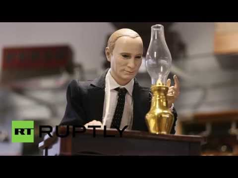 Germany: Putin figurine signing Crimea into Federation sells for  €30,000 at auction