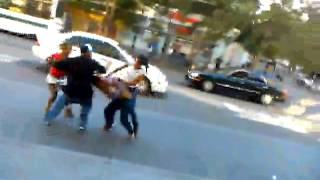 downtown Oakland fight.. girl almost get hit by bu