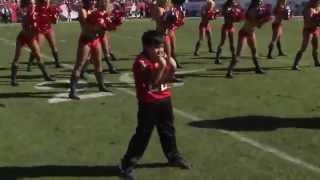 Kid Dances With NFL Cheerleaders.