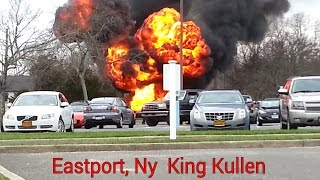 [Cars on fire and exploding in shopping center] Video