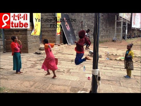 Children playing around Meskel square Addis Ababa Ethiopia . What is this game called?