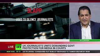 UK journalists call for the British government to act against 'intimidating' lawsuits
