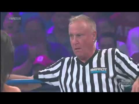 What Did I Just See?!: Madison Rayne kisses referee, Earl Hebner