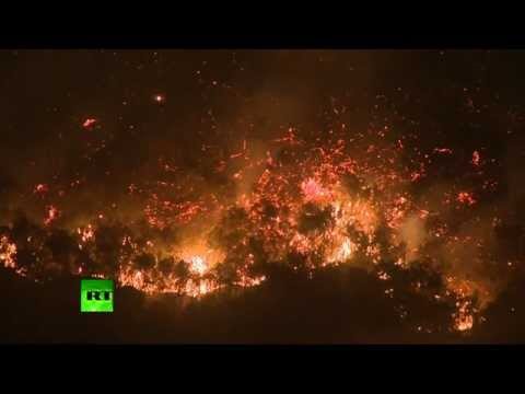 Video: Wildfires engulf southern California