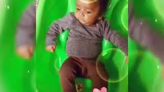 Cute baby Trying to swimming  in virtual tub ...