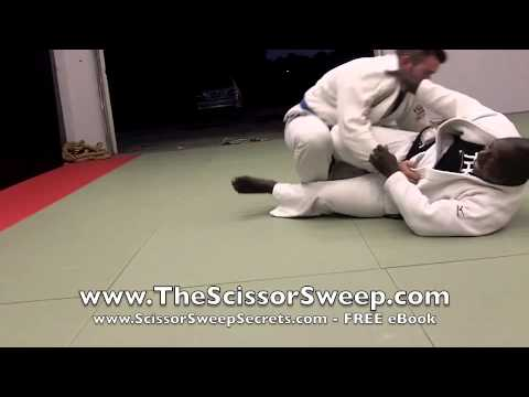 The Closed Guard Scissor Sweep | How To Perform Scissor Sweep When Opponent Puts Their Knee Up Image 1