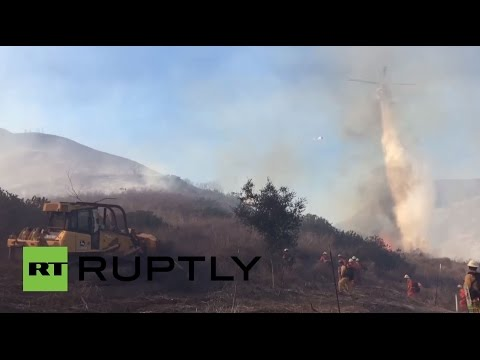 Helicopters battle against 1,200 acre wildfire in California