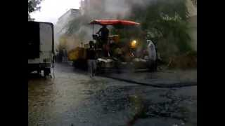 New Delhi, India has technology to lay bitumen roads in heavy rains !!!