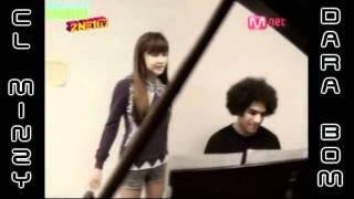 Park Bom singing and playing piano