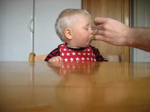 Cute baby sleeping and eating