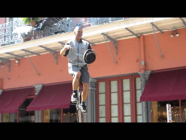 New Orleans Unicycle Street Performer Juggling Act