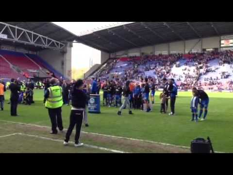 Wigan Athletic players show off the FA Cup