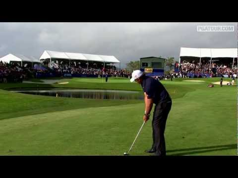 "In the final round of the Farmers Insurance Open, Phil Mickelson thrills the crowd at Torrey Pines by having Jim ""Bones"" Mackay tend the flag on his approach shot into the par-5 finishing hole."