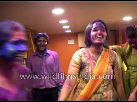 People dance after Holi celebration at their office in India
