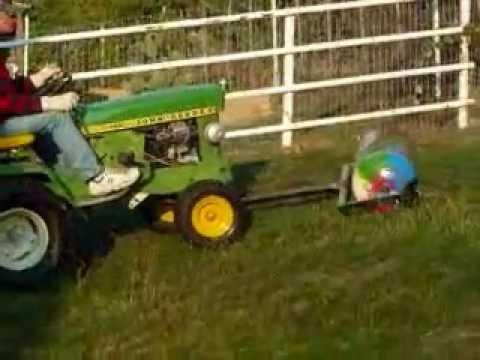 lawn roller, homemade,john deere 140, old propane tank