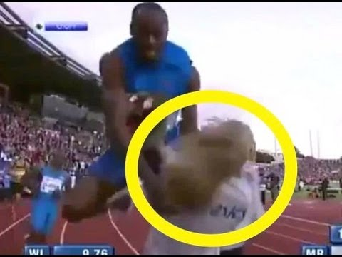 Usain Bolt CRASHES into spectator after setting 100m World Record!