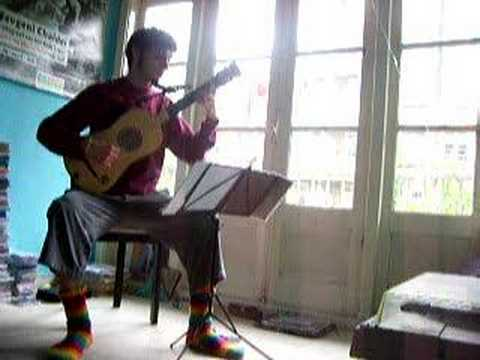 Cute Guy with awesome socks plays Baroque Guitar