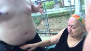 Young fat man gives grandma lap dance