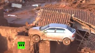 Aerial: Town swallowed by toxic mud after dam break in Brazil