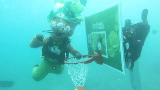 Lipko plays basketball underwater