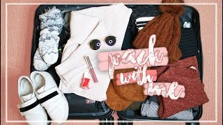 WHAT TO PACK IN A CARRY ON SUITCASE FOR A WINTER VACATION! // Pack With Me