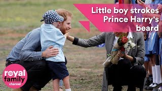 Cute Alert: Little boy strokes Prince Harry's beard and gives hugs
