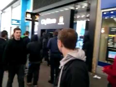 Man Utd fans burn Man City Scarfs outside the City store in Manchester City Centre!!!