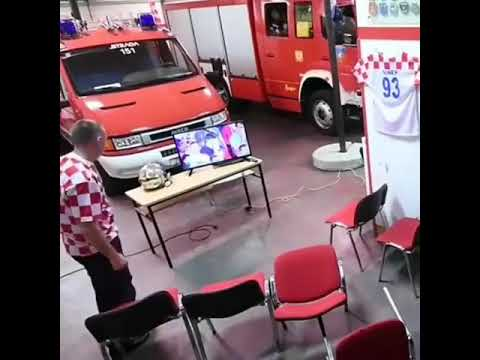 Fan firefighter of Croatia watching The world Cup Russia 2018 [ Croatia 2 - 1 England ] thumbnail