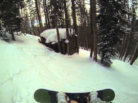 Snowboarding face plant in trees