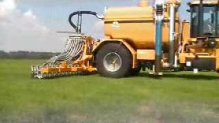 Challenger TerraGator 8333 in action injecting manure on grassland