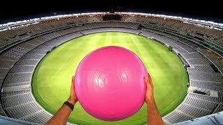 EXERCISE BALL GOLF with MAGNUS EFFECT from STADIUM ROOF!