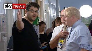 Angry father confronts PM during hospital visit