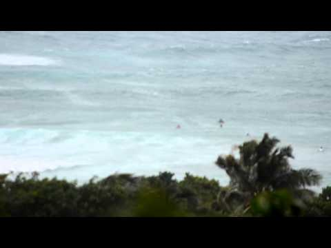 Surfers at Anse de Toiny during Tropical Storm Irene