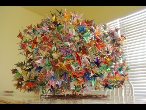 Construction of 1000 origami folding paper cranes on a wired tree