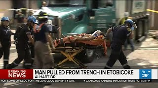Crews work to rescue man trapped in trench in Etobicoke
