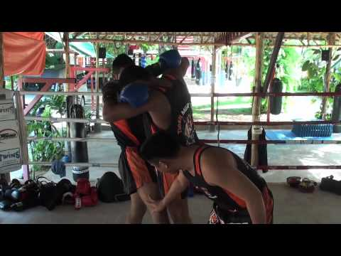 Tiger Muay Thai Techniques: both hands inside clinch, bump standing leg and throw opponent Image 1