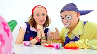 Mary cooks breakfast for Andrew the clown.